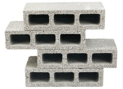 Three gray concrete construction blocks in a stack, isolated on white background.
