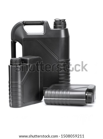 three gray plastic cans for lubricants without a label, chemical container isolated on white #1508059211