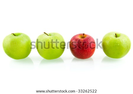 Three green apples with one red apple isolated on white background