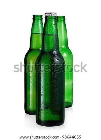Three green beer bottles