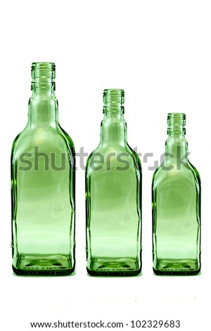 Three green bottle isolated on white background