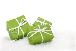 Three green Christmas gift boxes isolated on white background