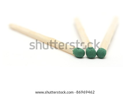 three green match on a white background