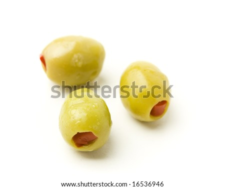 Three green olives on white