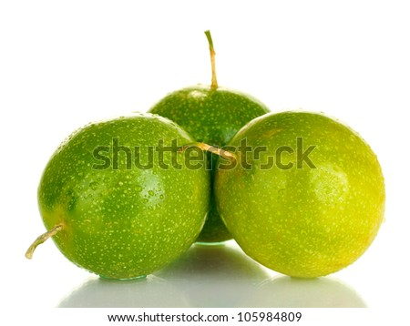 three green passion fruit isolated on white