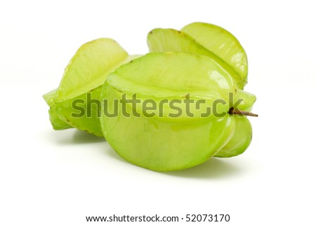 Three green star fruits on white background