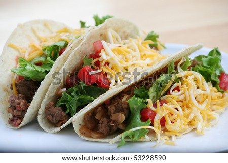 Three Ground Beef Tacos on a White Plate