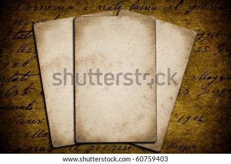 Three grunge papers on a grunge background