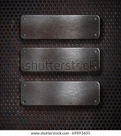three grunge rusty metal plates over grid background - stock photo
