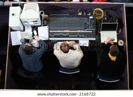 Three guys at audio control