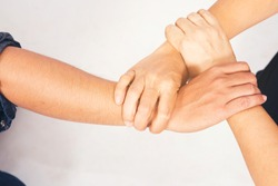 Three hand hold together like triangle shape, mean be in harmony,agreement,power and friendship in business or team.