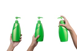 Three Hand holding green pump head shampoo bottles isolated on white background.