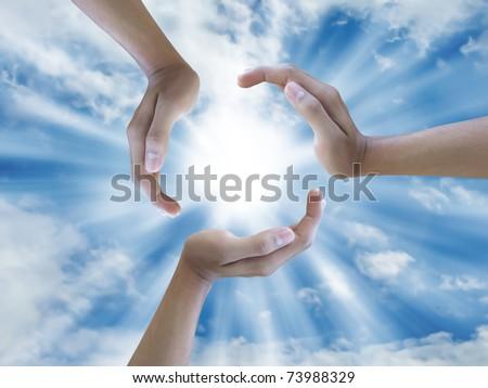 stock photo : three hand holding the sun