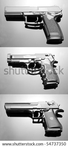 Three handguns. Beretta 92, Desert Eagle and M23 Double Eagle