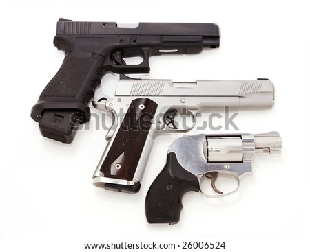 Three handguns isolated on white
