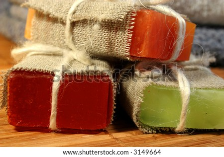 Three handmade soap on a bamboo mat