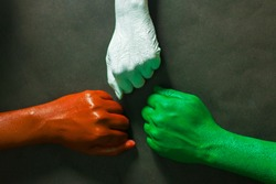 three hands are painted with three colors,saffron,white and green to represent tricolor Indian national flag.15 August Independence day India.celebration of freedom.symbol of brotherhood.