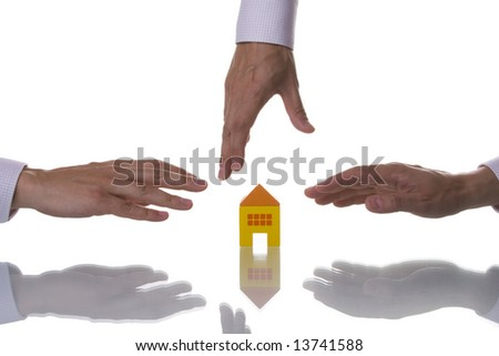Three hands trying to reach a house toy