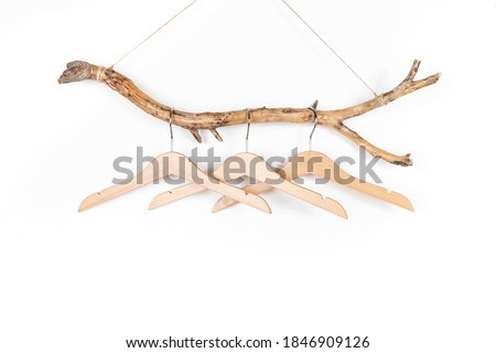 Three hangers on a thick wooden stick, great design for any purposes. Concept Eco-Friendly Homes or Season sale. Front view. Foto d'archivio ©