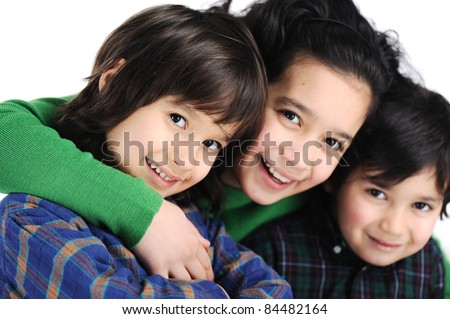 Three happy children, love, care and togetherness - stock photo