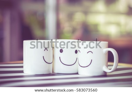 three happy cups on the wood...