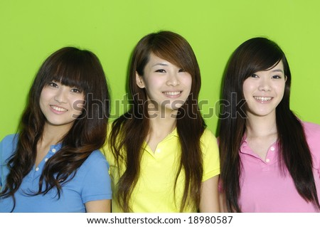 three happy girls a over green background