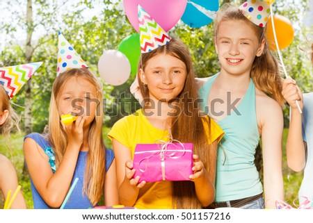 Three happy girls celebrating Birthday outdoors #501157216