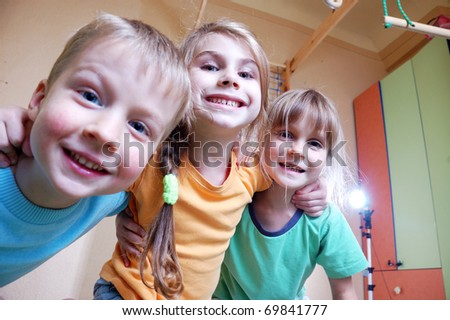 three happy kid in a domestic sports room