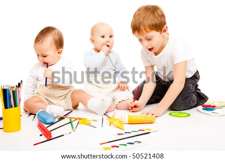 Three happy kids having art time, over white - stock photo