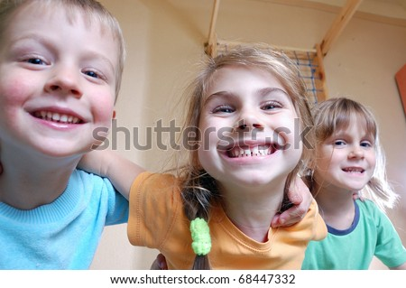 three happy kids playing together