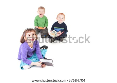 Three happy kids reading books and looking up. Isolated on white with shadows.