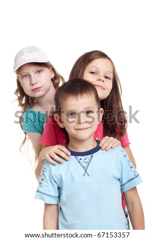 three happy little children standing in studio - stock photo