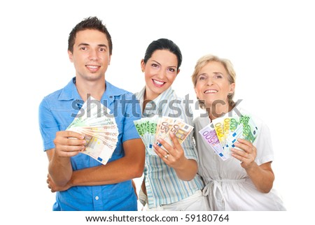Three happy people in a row holding a lot of money and smiling isolated on white background