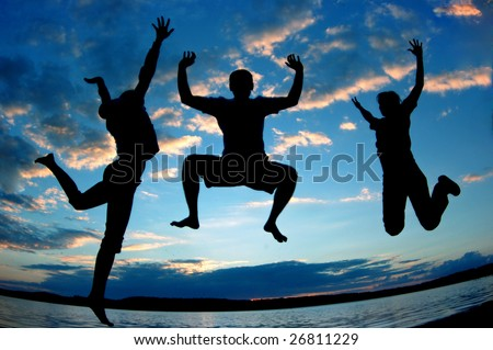 Three happy people jumping.