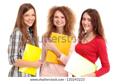Three happy students standing together with fun, while smiling and looking at camera isolated on white background