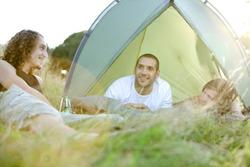 Three healthy young men camping