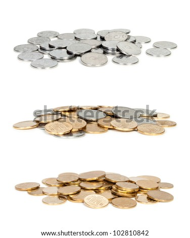 three Heaps of coins isolated on white background