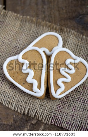 Three Heart shape gingerbread Cookies with icing on sacking