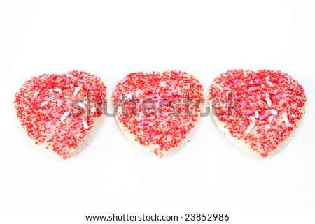 Three heart shaped cookies isolated on a white background.