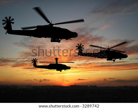 Three helicopters in Iraq over sunset