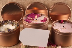Three homemade candles with blank card, candles sat in bronze pots with dried flowers