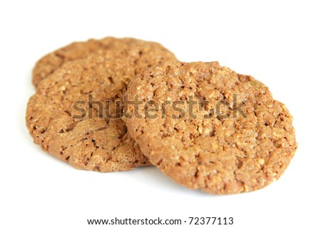 Three homemade oatmeal cookies isolated on white background