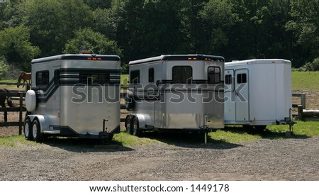 three horse trailers