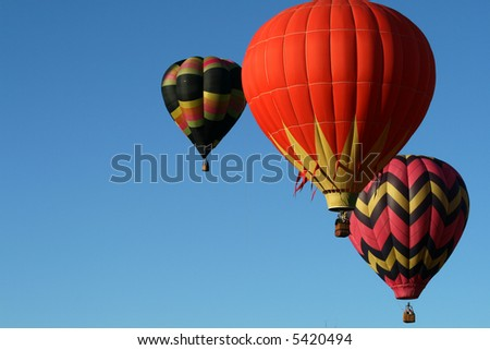 Three hot air balloons ascending - early morning
