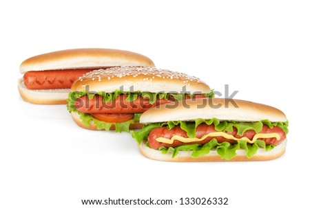 Three hot dogs with various ingredients. Isolated on white background