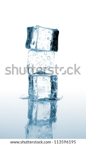 three ice cubes stacked on white