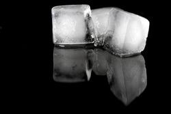 three icecubs on a black background