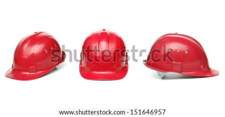 Three identical red hard hat.
