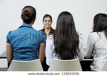 Three Indian colleagues from hr department interview a female applicant