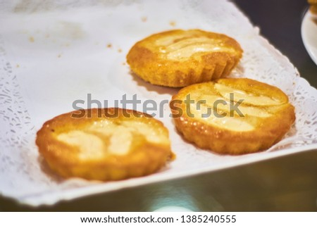 Three individual portions of round shaped apple cake. Delicious european pastry sweets.